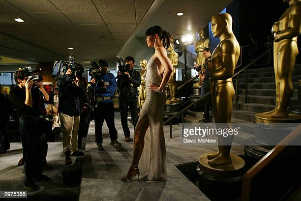 A model poses for photographers at the Oscar fashion preview on February 12 2004 in Los Angeles California Academy awards fashion coordinator Patty...