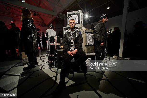 Model poses for photographs at the Fashion East installation during The London Collections: Men Autumn/Winter 2014 on January 6, 2014 in London,...