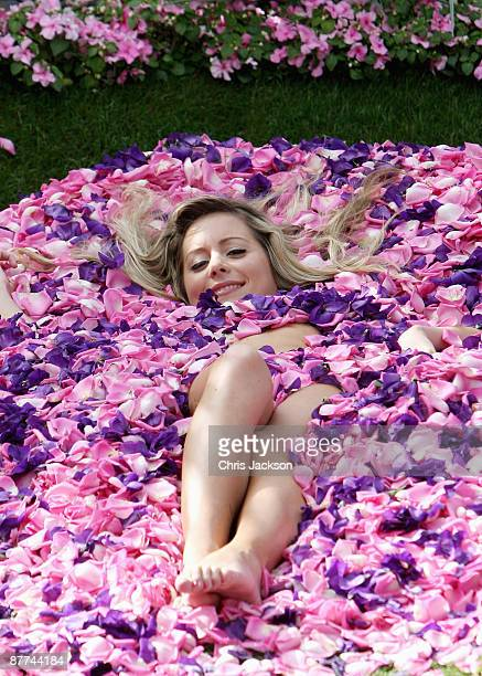 Model poses for photographs in the Quilted Velvet Garden during the Press and VIP preview day at Chelsea Flower Show at Royal Hospital Chelsea on May...