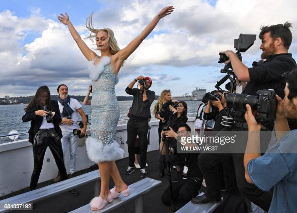 A model poses for photos after a parade by fashion label Dyspnea at Fashion Week Australia in Sydney on May 18 2017 / AFP PHOTO / WILLIAM WEST