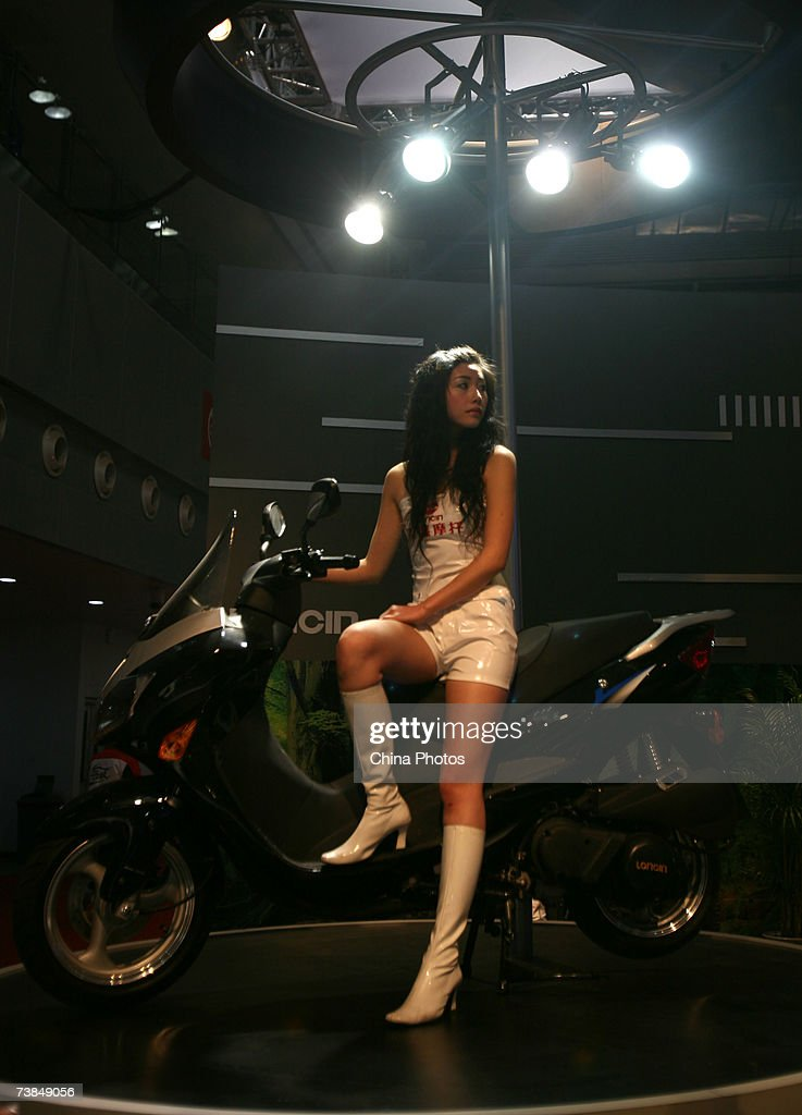 A model poses for pictures on a Loncin motorcycle at the 6th China International Motorcycle Trade Exhibition, at the Chongqing International Convention & Exhibition Center, on April 10, 2007 in Chongqing Municipality, China. Over 3,000 domestic and overseas motorcycle trade delegates attended the exhibition, the sole national exhibit in the motorcycle industry. China is the world's largest motorcycle producer and consumer.