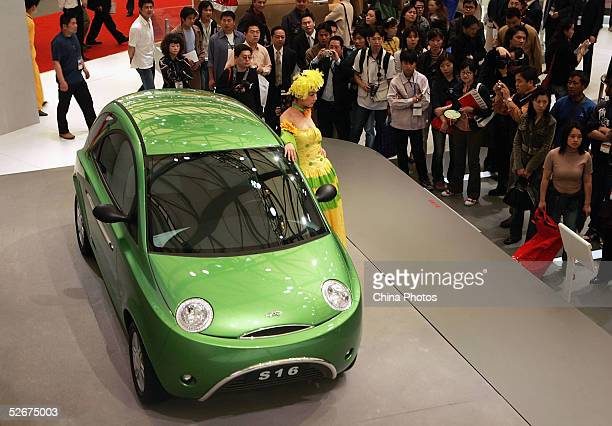 Model poses for pictures with SAIC Chery Automobile's S16 car at the Auto Shanghai 2005 Exhibition on April 21, 2005 in Shanghai, China. Top world...