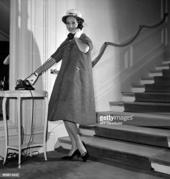 Model poses for the presentation of the first Yves Saint-Laurent's Dior collection, 04 February 1958, Avenue Montaigne in Paris. With this...