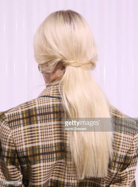 Model poses for TRESemme at Jonathan Simkhai for NYFW on February 9, 2019 in New York City.