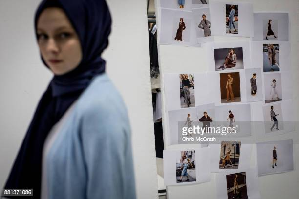 A model poses in front of posters showing looks and poses during a photo session for online modest clothing brand Modanisa on November 28 2017 in...