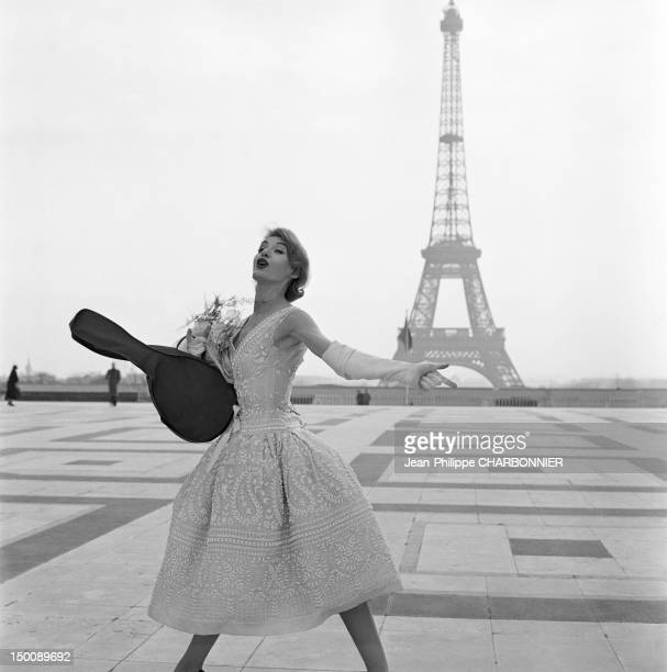 A model poses in front of the Eiffel Tower 1960 in Paris France
