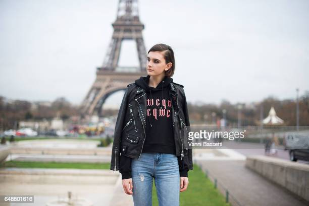 A model poses in front of the Eiffel tower wearing an Alexander McQueen sweatshirt after the Hermes show at the Palais de Chaillot during Paris...