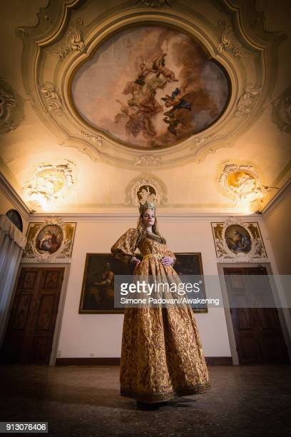 A model poses in Guarana room that appears for the first time after the renewing of Scuola Grande San Giovanni Evangelista wearing a Venezia costume...