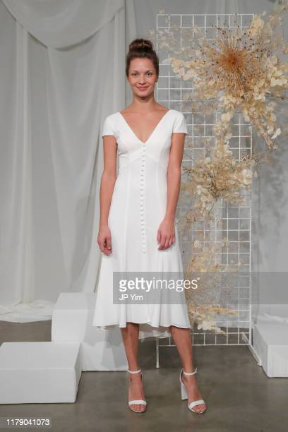 Model poses in Little White Dress during Amsale Fall 2020 on October 04, 2019 in New York City.