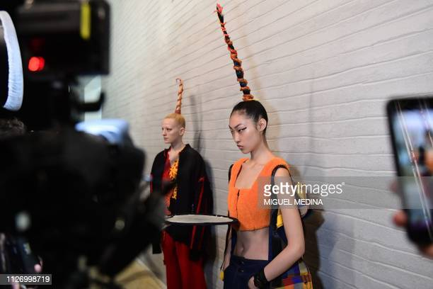 A model poses in the backstage prior to the Angel Chen women's Fall/Winter 2019/2020 collection fashion show on February 24 2019 in Milan