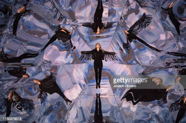 A model poses inside Laura Buckley's interactive largescale Kaleidoscope Fata Morgana which is on display at the Saatchi Gallery on March 14 2019 in...