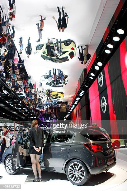 A model poses next an Opel Corsa during the Paris Motor Show on October 04 in Paris France More than a million visitors are expected at the 'Mondial...