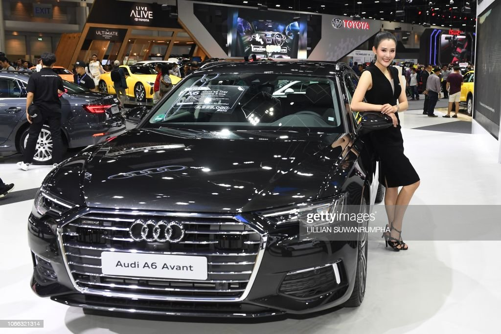 A Model Poses Next To A 2019 Audi A8 Avant During The Thailand