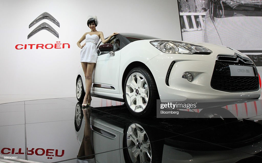 A model poses next to a Citroen DS3 vehicle, displayed at the Beijing Auto Show in Beijing, China, on Friday, April 23, 2010. The show will be held through April 27. Photographer: Tomohiro Ohsumi/Bloomberg via Getty Images