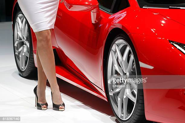 A model poses next to a Lamborghini Huracan automobile during the second press day of the 86th Geneva International Motor Show on March 2 2016 in...