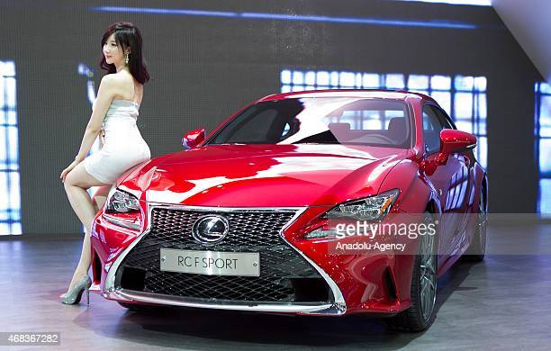 A model poses next to a Lexus RC F SPORT at the Seoul Motor Show 2015 at KINTEX on April 02 2015 in Seoul South Korea Kim Jong Hyun / Anadolu Agency