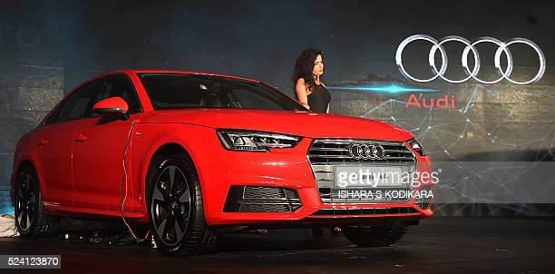 A model poses next to a new Audi A4 during its launch in Colombo on April 25 2016 / AFP / ISHARA SKODIKARA