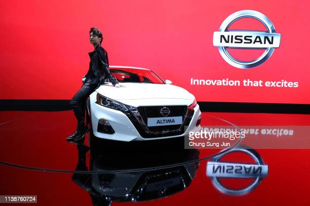 Model poses next to a NISSAN Altima at the Seoul Motor Show 2019 at KINTEX on March 28, 2019 in Goyang, South Korea. The Seoul Motor Show 2015 will...
