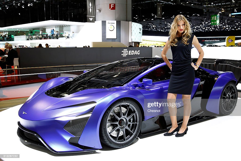 A model poses next to a Techrules AT 96 concept car during the second press day of the 86th Geneva International Motor Show on March 2, 2016 in Geneva, Switzerland. The 86th International Motor Show runs from March 3 -13 and features production and concept cars from the World's biggest car manufacturers.
