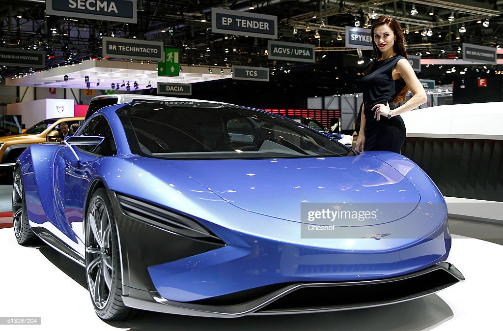 A model poses next to a Techrules GT 96 concept car during the second press day of the 86th Geneva International Motor Show on March 2, 2016 in Geneva, Switzerland. The 86th International Motor Show runs from March 3 -13 and features production and concept cars from the World's biggest car manufacturers.