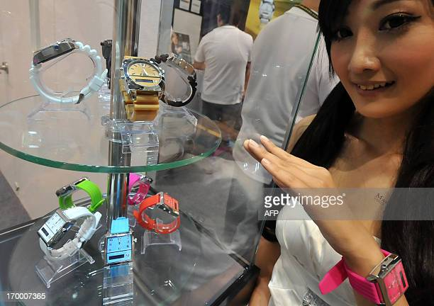 A model poses next to Martian Watches' new 'Voice Command Watches' which are compatible for when speaking with iPhone and Android mobiles during...