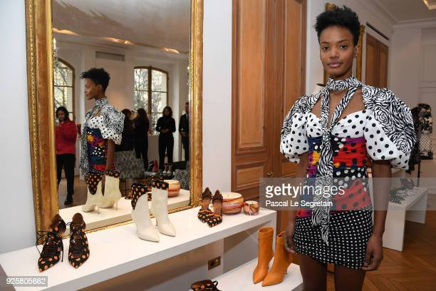 A model poses next to shoes made for Emanuel Ungaro by Malone Souliers during the Emanuel Ungaro presentation as part of the Paris Fashion Week...
