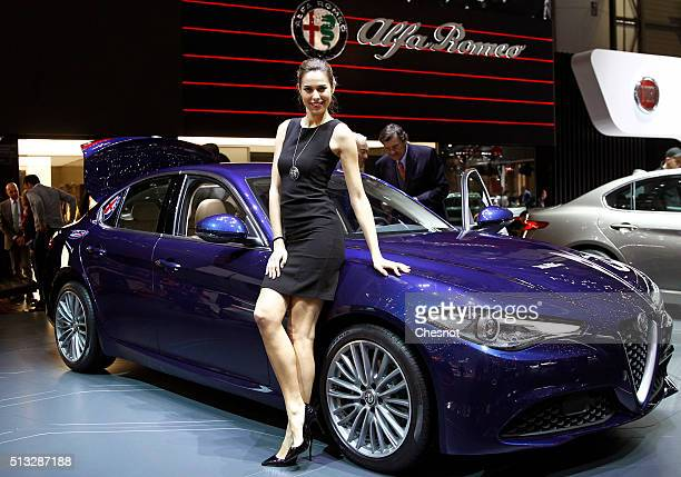 A model poses next to the new Alfa Romeo Giulia during the second press day of the 86th Geneva International Motor Show on March 2 2016 in Geneva...