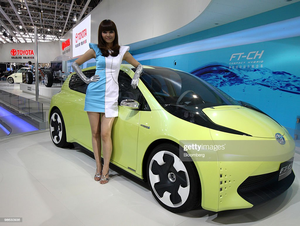 A model poses next to Toyota Motor Corp.'s FT-CH concept hybrid vehicle, displayed at the Beijing Auto Show in Beijing, China, on Friday, April 23, 2010. The show will be held through April 27. Photographer: Tomohiro Ohsumi/Bloomberg via Getty Images
