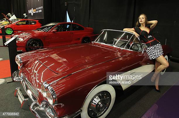 A model poses on a Chevrolet Corvette car displayed during the Lebanon Motorsport and Tuning Show on June 13 2015 in Jounieh north of Beirut AFP...