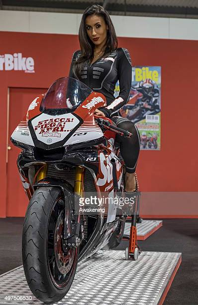 A model poses on a SuperBike at the opening day of the Milan Motorcycle Show on November 17 2015 in Milan Italy EICMA or the Milan Motorcycle Show is...
