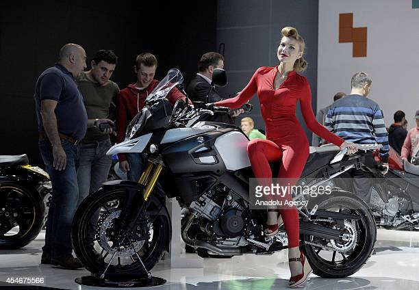 A model poses on a Suziki motobike exhibited during the Moscow International Motor Show 'Autosalon 2014' the leading automotive event of the year in...