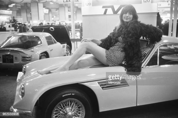 Model poses on the bonnet of a TVR at the Motor Show 15th October 1968