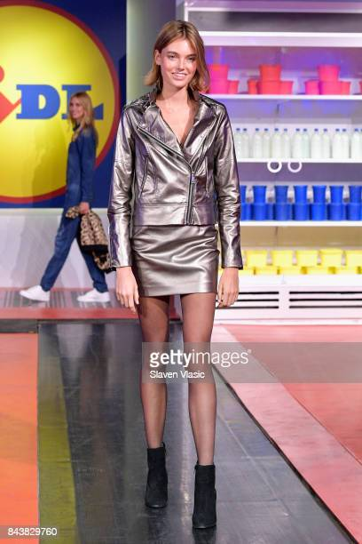 A model poses on the conveyor belt runway during the Esmara By Heidi Klum Lidl Fashion Presentation at New York Fashion Week #Letswow at ArtBeam on...