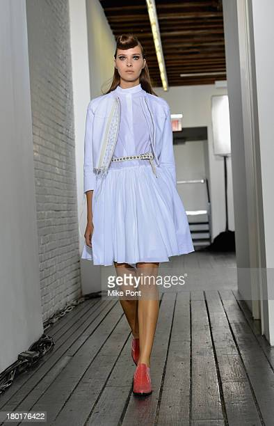A model poses on the runway at the Hache presentation during MercedesBenz Fashion Week Spring 2014 at Hosfelt Gallery on September 9 2013 in New York...