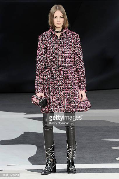 A model poses on the runway during the Chanel Fall/Winter 2013/14 ReadytoWear show as part of Paris Fashion Week at Grand Palais on March 5 2013 in...