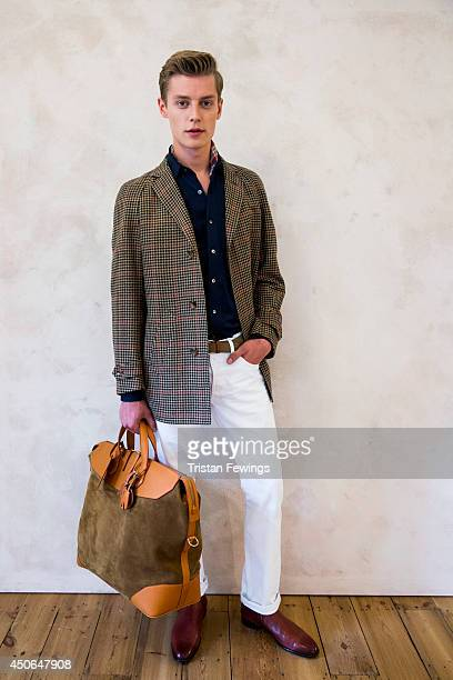 A model poses on the runway during the dunhill presentation at the London Collections Men SS15 on June 15 2014 in London England