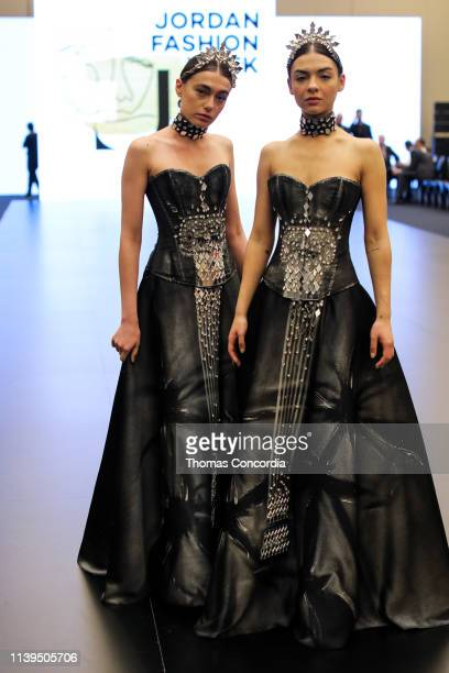 A model poses on the runway during The Handmade Dealer Fashion Presentation in the Kempinski Hotel Amman during Jordan Fashion Week on March 30 2019...