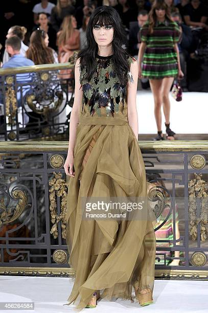 Model poses on the runway during the John Galliano show as part of the Paris Fashion Week Womenswear Spring/Summer 2015 on September 28, 2014 in...