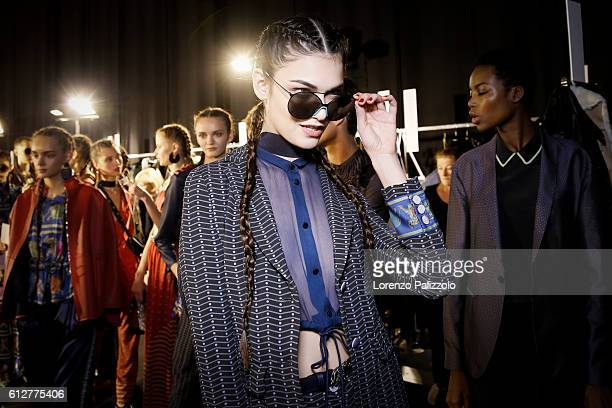 A Model poses prior the Emporio Armani show as part of the Paris Fashion Week Womenswear Spring/Summer 2017 on October 3 2016 in Paris France