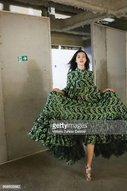 A model poses prior the Giambattista Valli show as part of the Paris Fashion Week Womenswear Spring/Summer 2018 on October 2 2017 in Paris France
