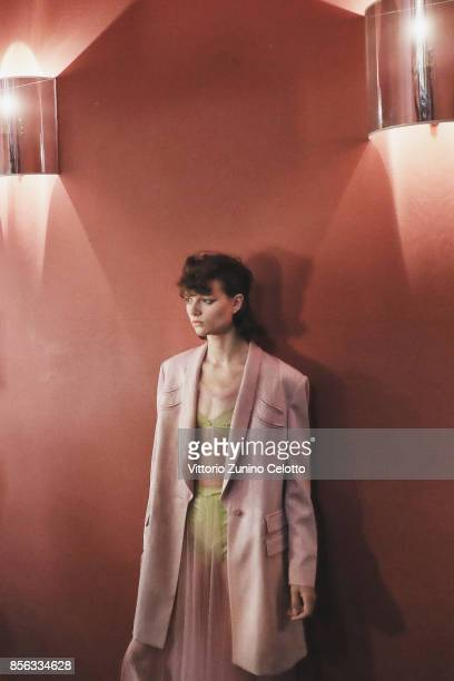 A model poses prior the John Galliano show as part of the Paris Fashion Week Womenswear Spring/Summer 2018 on October 1 2017 in Paris France