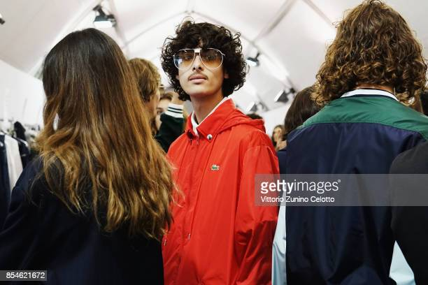 A model poses prior the Lacoste show as part of the Paris Fashion Week Womenswear Spring/Summer 2018 on September 27 2017 in Paris France