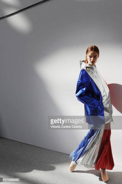 A model poses prior the Moncler Gamme Rouge show as part of the Paris Fashion Week Womenswear Spring/Summer 2018 on October 3 2017 in Paris France