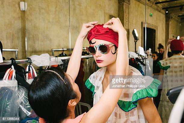 A model poses prior the Tsumori Chisato Presentation as part of the Paris Fashion Week Womenswear Spring/Summer 2017 on September 29 2016 in Paris...