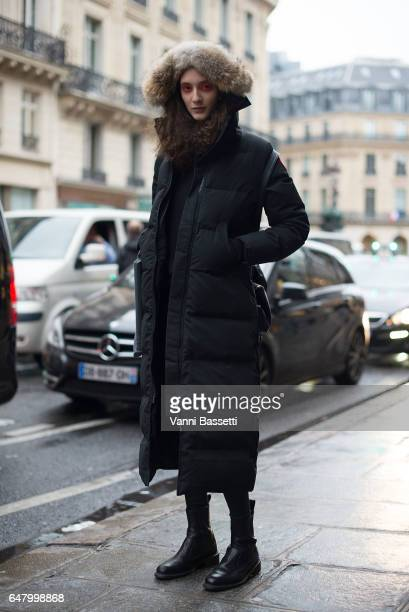 A model poses wearing a Canada Goose down after the Vivienne Westwood show at the Hotel Intercontinental on March 4 2017 in Paris France