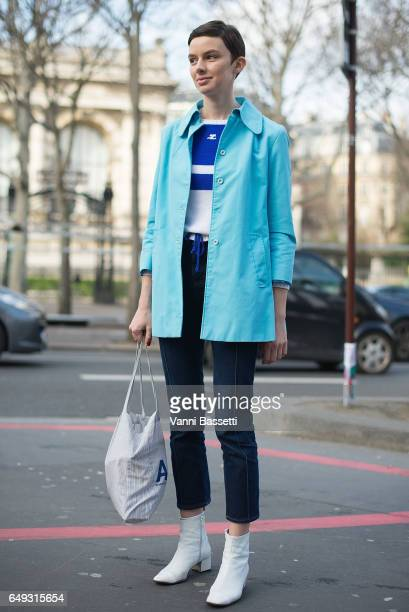 A model poses wearing a Courreges top and APC tote bag after the Jourden presentation at the Palais de Tokyo during Paris Fashion Week Womenswear FW...