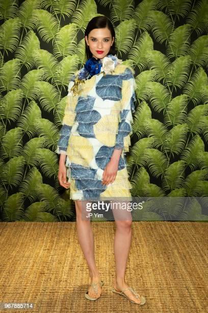 A model poses wearing Badgley Mischka Resort 2019 at the Badgley Mischka Showroom on June 5 2018 in New York City