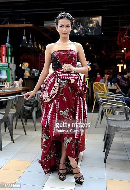 A model poses wearing batik design by Embran Nawawi on October 1 2013 in Surabaya Indonesia UNESCO give recognition and formally endorsed Indonesian...