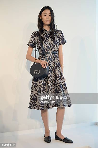 A model poses wearing Brooks Brothers Women at the Brooks Brothers SS 2017 Presentation during New York Fashion Week with creative director Zac Posen...