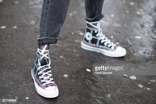 A model poses wearing JW Anderson X Converse shoes after the Masha Ma show at the Palais de Tokyo during Paris Fashion Week Womenswear FW 18/19 on...